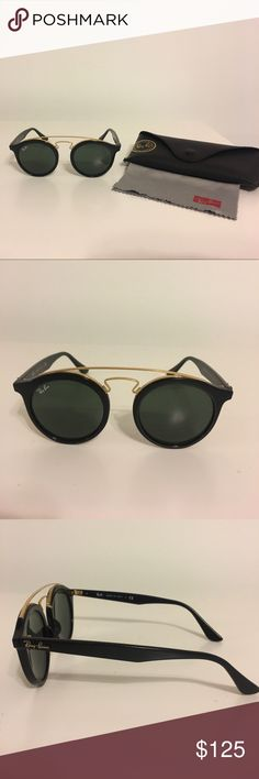 Authentic Rayban sunglasses Like new condition. Rayban sunglasses with case and cloth. Black plastic frames with gold metal detail. Only worn twice. Ray-Ban Accessories Sunglasses