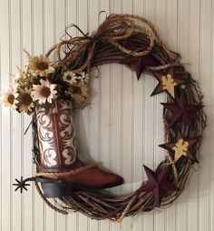 The Yee Haw Boot wreath has got a lot of rustic western personality with a pretty, large tin cowboy boot which is open to hold the florals of the season be it poinsettias and berries or sunflowers in Western Wreaths, Country Wreaths, Fall Wreaths, Christmas Wreaths, Door Wreaths, Western Crafts, Country Crafts, Western Theme, Western Decor