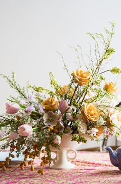 These pink and yellow blooms look perfect as the centerpiece for a pretty pink tea party!