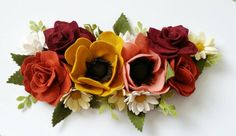 The Grey Rose specializes in designing one of a kind interchangeable, felt flower wreath decorations. The felt flowers are cut by hand and by die
