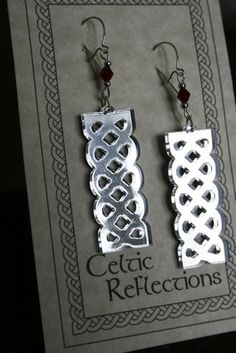 Celtic Reflections Earrings by Prairie Engraving. Laser cut mirrored acrylic, currently in silver and purple. www.prairieengraving.ca