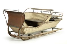 "VICTORIAN WICKER SLEIGH.  American, late 19th century, wicker, wood, and iron. Cutter sleigh with traces of its original paint decoration. Only minor damage to frame and wicker. 83""l.  Estimate $ 1,500-2,000"