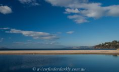 I have been sharing a number of black and white photos lately. But sometimes the photograph  just has to be in colour.  This simple landscape relies on the contrast of the shades of blue with a contrasting yellow sandbar.   Tips  on photographs without distractions http://aviewfinderdarkly.com.au/2014/04/10/five-tips-for-photographs-without-clutter/