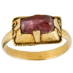 Gothic Gemstone Ring; Western Europe  13th-14th centuries. Simple bezel with flat prints to hold stone in place. Wire wrapped rope edging.