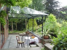 Love these Glass and Iron Canopy Porch/Patio Covers!!!