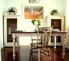 Distressed table and chair in a French country dining nook
