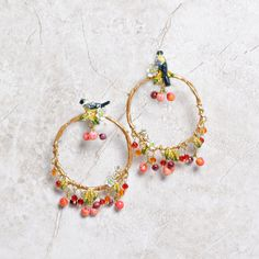These show-stopping hoop earrings by Les Nereides will bring a smile to your face every time you add them to your ensemble! The delicate hand enameled detailed gold finch and cherry tree branch create