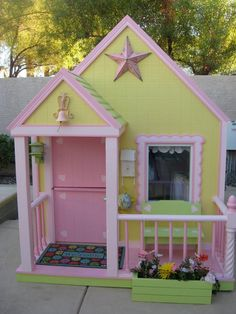yellow & pink painted playhouse