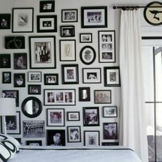 Create a family photo wall: black frames unify family photos and other images. Great guest room idea. Coastalliving.com