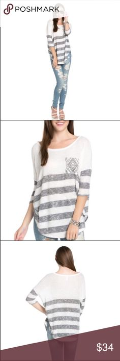 🆕Fall favorite striped knit tee Comfy and cute knit tee! Perfect for cool, fall days! Unique gray and white design with horizontal stripes. Size small/medium. (Marked as a medium because of oversized fit). I'm a true medium and have plenty of room in this. 3/4-length sleeves. The Blossom Apparel Tops Tees - Long Sleeve