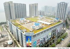 A strange place for some villas. Read more about this rooftop neighborhood in Zhuzhou, China. http://realestate.aol.com/blog/2012/08/17/china-villas-built-on-shopping-mall-roof/#