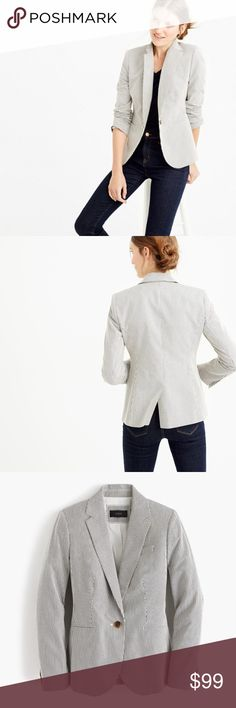 """Mini-Stripe Blazer (White/Navy) Condition: Like new, only worn once! Only selling because it is a tad too big on me. Material: Cotton Measurements per J Crew: Tailored for a fitted look. Body length: 26"""". Sleeve length: 32"""". Hits at hip. Description: Slim, feminine fit, finished interior with hot pink piping & handkerchief pocket. This edition is """"springified,"""" thanks to striped lightweight cotton. Notch collar with felt undercollar. Button closure. Functional buttons at cuffs. Pockets…"""