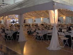 Tents can be set up inside to define a space--such as this wedding reception held inside a church gymnasium.