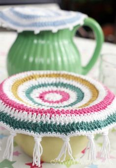 cool crocheted food covers....i usually crochet on beads to the tassels to weigh it down a bit...helps it stay a bit more stable too.