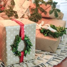 christmas wrapping This Christmas, make a simply wrapped package look much cuter by adding a mini boxwood wreath Gift Wrap Adornment youll have everyone at the family gift swap wishing you were their Secret Santa. Noel Christmas, Country Christmas, All Things Christmas, Winter Christmas, Christmas Crafts, Christmas Decorations, Christmas Island, Christmas Movies, Christmas 2019