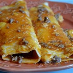 They most delicious looking Beef Enchiladas from Allrecipes.com. That you and the kids will enjoy