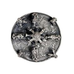 This silver disc brooch (Viking, 10th century AD Probably found on the island of Gotland, Sweden) is elaborately decorated with Borre Style interlace and animal masks. Figures of four backward-biting animals are riveted around the high central boss, itself formed of eight long-necked animal heads.