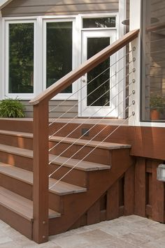 Fiberon composite steps and horizontal wire railing that leads to new back porch. Designed and built by Atlanta Decking & Fence. Step Railing Outdoor, Horizontal Deck Railing, Decking Fence, Patio Railing, Deck Patio, Backyard, Deck Steps, Porch Steps, Front Steps
