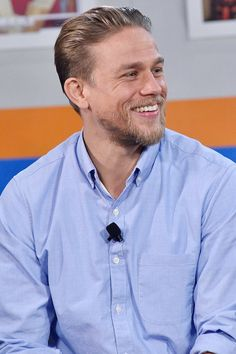 Pin for Later: Charlie Hunnam Brings His Sexy Smirk to Comic-Con