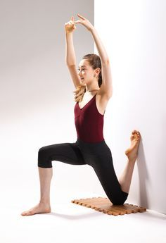 Hip flexor stretch to improve arabesque. Hands can be on thigh or on floor as a modification