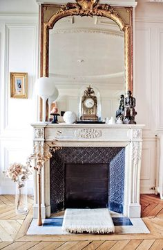 Stunning fireplace with gilded mirror.