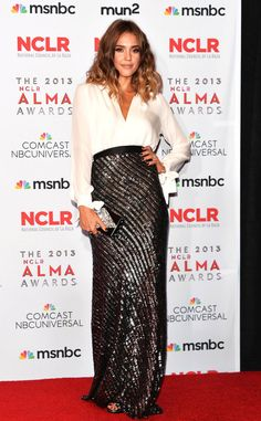 Jessica Alba takes to the red carpet at the 2013 NCLR ALMA Awards wearing a Juan Carlos Obando blouse and metallic skirt ensemble with an Edie Parker clutch and Jimmy Choo heels.