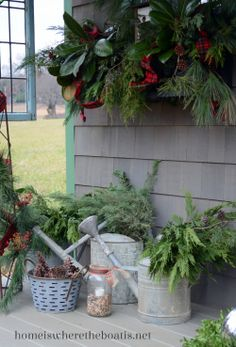 Christmas greens in watering cans
