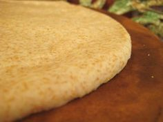 Whole Wheat Pizza Dough  This is a great, easy recipe!! I used 1 cup whole wheat flour & 1/2 cup all purpose--added dry Italian seasoning, 1/2 tsp salt & 1/4 tsp garlic powder. I used 2/3 cup hot water, since I used more whole wheat & the dough was easy to mix with the dough hooks of my Kitchen mixer. Makes 2 nine-inch thin-crust pizzas or one 12-inch with med-thick crust.