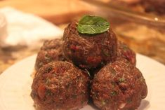 Paleo Greek Meatballs with Lamb, ground beef, chives, garlic, parsley, egg, mint, oregano, cumin, and cinnamon, apricots, and kalamata olives.