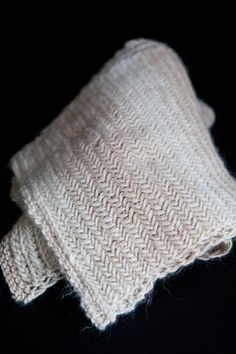 Herringbone Scarf Pattern - great video on how to knit the pattern. I just knit up a little swatch, both sides look great.