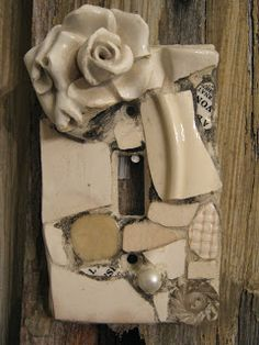 Mosaic single switch plate with white ceramic flower.