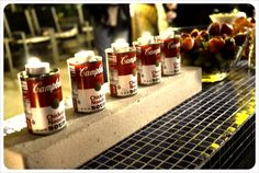 Cambell's Soup cans as tea light holders at an Andy Warhol themed party