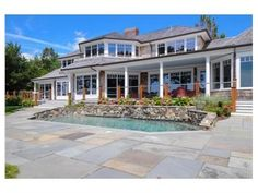 Marion, MA 02738 — Located in the premier Allen's Point area of Marion, this picturesque waterfront home is sited on a slight bluff that enhances and showcases the breathtaking views of Sippican Harbor and Buzzards Bay beyond. Recently remodeled, this stunning five bedroom estate offers a deep water pier, pool, guest cottage and very private grounds. A special feature of this home is the attached au-pair/in-law suite which can be accessed via the house or a separate…