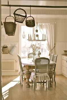 Cottage style table and chairs, love the cottage country look!  Want to redo my house