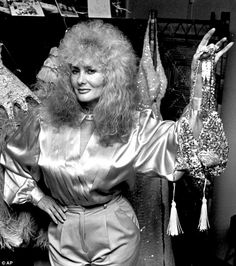 Longtime preformer: In this December 1985 photo, stripper Carol Doda holds up her tassels while posing in her apartment in San Francisco.Doda first went topless in 1964 at the Condor Club — a move that changed every nightspot on busy Broadway in San Francisco