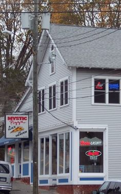"""The real Mystic Pizza is located at 56 West Main Street in Mystic and, though the shop has been renovated since it burst into fame in the late eighties, it still has that small-town """"Slice of Heaven"""" vibe. The servers still wear the """"Slice of Heaven"""" t-shirts like the girls wore in the movie,"""