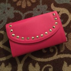 """NWOT Studded Clutch/cross body This is brand new without tags. Never used. Dimensions are 9"""" x 5"""". Faux leather like material. Can be used as a clutch and has detachable strap to use as cross body. Bags Clutches & Wristlets"""