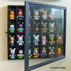 Good idea: using a shot glass display case to display Vinylmations!