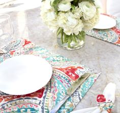 Kelly Ripa Home Bright and Lively in Nectar adds a pop of color to this placesetting.