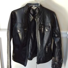 Faux Leather Jacket A staple piece in every wardrobe! This jacket is like new, I wore it twice and outgrew it. Silver hardware, multiple functioning pockets, black lining. It does have a worn look to it. Mainly around collar and seams throughout, I purchased it this way. Maurices Jackets & Coats