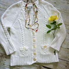 """Banana Republic cotton Vneck cableknit cardi Cream cableknit 100% cotton cardigan from Banana Republic. Vneck. Pearlized buttons. Bracelet sleeves. In mint condition. Machine wash. 22.5""""L. 17"""" bust laying flat. Size small. Banana Republic Sweaters Cardigans"""
