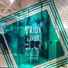 SPRINGFIELD. Green vinyl. Enjoy your store. Store window.