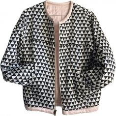 Gorgeous reversible 'teddy' jacket: one side quilted pale pink (mix of silk and cotton) and the other with a black and white design (in silk). Very good condition. Spring 14 collection.