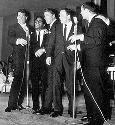 The Rat Pack on stage together in a 1960s' performance. Frank Sinatra, Dean Martin, Sammy Davis Jr., Peter Lawford, Joey Bishop.