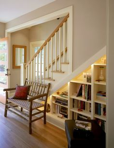 Love the idea of putting bookshelves under the stairs.