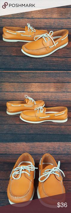 Sperry Top-Sider Orange Lace up Casual Boat Shoes Sperry Top-Sider 2 Eye Orange Mens Lace up Casual Boating Shoes. Orange and White style #10682658. Genuine, hand-sewn leather uppers w/ true moccasin construction to ensure lasting wear. 360° lacing system with rustproof eyelets for a secure fit. Genuine rawhide laces. Molded EVA heel cup & Ortholite underfoot cushioning enhances shock absorption for comfort. Razor-cut Wave-Sipin for traction with non-marking rubber outsoles. Excellent Used…