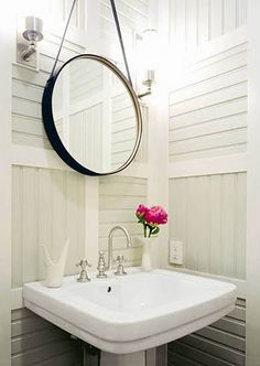 Cute cottage bathroom - love the mirror hung by a rope!