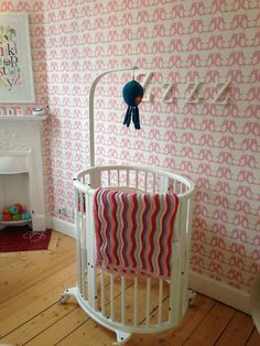 Isak Penguin wallpaper in Plum.  Available from Great Little Rooms