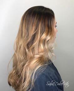 Dark brown to light blonde balayage