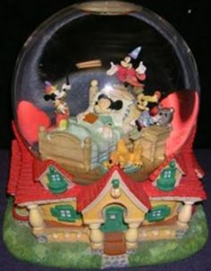 Disney Snowglobes Collectors Guide: Mickey Mouse dreams Snowglobe (Sitting on my mantle)